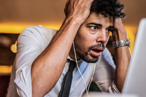 Frustrated man working at computer